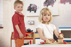Two Young Children Playing Together at Montessori/ Royalty Free Stock Photos