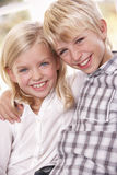 Two young children pose together Royalty Free Stock Images