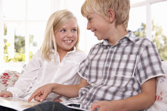 Two young children read together Royalty Free Stock Image