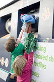 Two young children recycling clothes Stock Photography