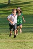 Two Young Children Running Royalty Free Stock Image