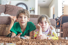 Two young children watching tv Stock Image