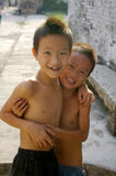 Two young Chinese boys smiling in a village Stock Photography