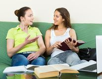 Two young clever girls studying Royalty Free Stock Photos