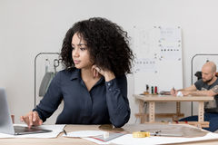 Two young co-workers Stock Images