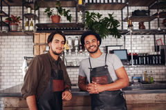 Two young coffee shop owners at the counter Royalty Free Stock Photography