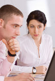 Two young colleagues Royalty Free Stock Photos