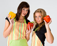 Two young cooks with peppers Stock Photography