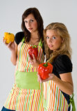 Two young cooks and peppers Stock Photo