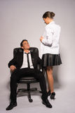 Two Young Couple in Corporate Attire Talking Stock Photo