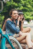 Two young couple. Happy girl and boy sitting on the stairs. Outdoors Royalty Free Stock Photos
