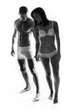 Two Young Couple Showing Perfect Body Figures Stock Images