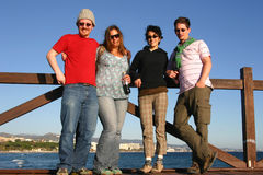 Two Young Couples. On the Pier in Marbella, Spain royalty free stock image