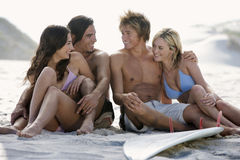 Two young couples on a beach Royalty Free Stock Image