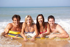 Two young couples on beach holiday royalty free stock images