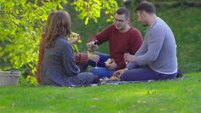 Two young couples celebrating together in a park
