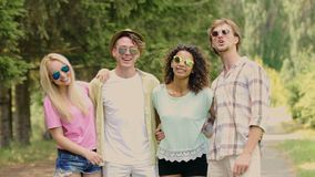 Two young couples posing embraced for camera, enjoying summer outdoor activities. Stock footage stock video footage