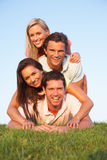Two, young couples posing on a field Stock Images