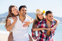Two young couples on sand beach Stock Image
