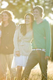 Two young couples standing in a field, smiling Royalty Free Stock Photography