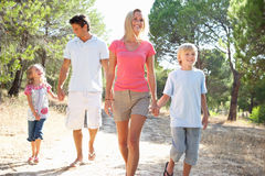 Two young couples, together, running in park Stock Photos
