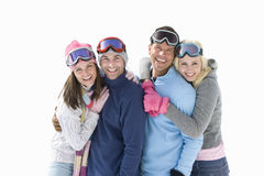 Two young couples in winter clothing, smiling, portrait, cut out Stock Photography