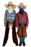 Two young cowboys with bandannas covering their fa. Two young cowboys with bandannas covering faces stock images