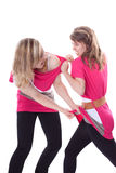 Two young cute woman are fighting royalty free stock images