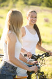 Two young cyclist girlfriends Royalty Free Stock Photos