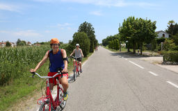 Two young cyclists riding bicycles on European roads Royalty Free Stock Photography
