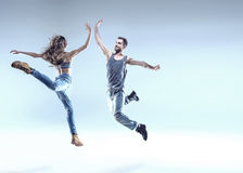 Two young dancers in a jumping pose Royalty Free Stock Image