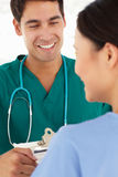 Two young doctors. Two happy young doctors chatting Royalty Free Stock Photo