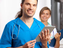 Two young doctors. In clinic Royalty Free Stock Photo
