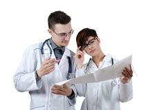 Two young doctors discuss the results of the electrocardiogram. Isolated on white Royalty Free Stock Image