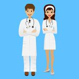 Two young doctors man and woman on blue background Royalty Free Stock Images