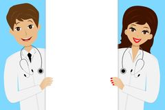 Two young doctors man and woman on blue background Royalty Free Stock Photography