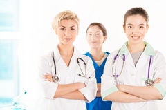 Two young doctors and nurse. Near the hospital window Royalty Free Stock Image
