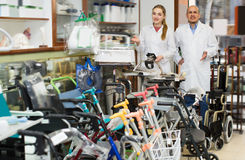 Two young doctors posing in orthopaedic shop. Two young doctors in white uniform posing in orthopaedic shop Royalty Free Stock Photography