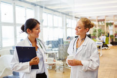 Two young doctors in their coffee break. Two young doctors in medical school in their coffee break Stock Photography