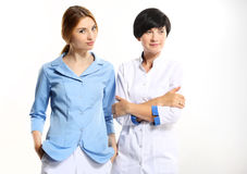 Two young doctors. On a white background Stock Images