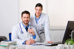 Two young doctors in white coat Stock Photos