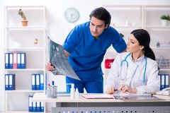 Two young doctors working in the clinic stock photos