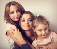 Two young emotional beautiful smiling women and happy joying fun. Kid girl hugging with love. Toned closeup portrait Royalty Free Stock Photos