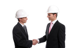 Two young Engineers closing a deal Royalty Free Stock Photography