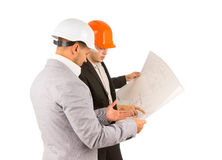 Two young engineers discussing a building plan Stock Photos