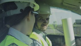 Two Young Engineers A Man And A Woman In Green Vests And Helmets stock video footage