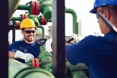 Two engineers working inside oil and gas refinery stock photos