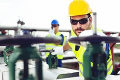 Two engineers working inside oil and gas refinery royalty free stock images