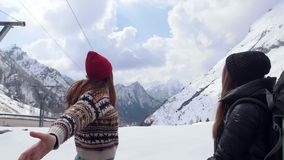 Two young excited women travelers happily jumping in Dolomites stock video