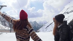 Two young excited women travelers looking around in Dolomites stock footage